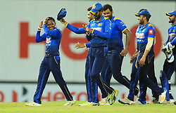 August 12, 2018 - Colombo, Sri Lanka - Sri Lankan cricketer Akila Dananjaya (L) walks away with his team members  after defeating South African cricket team   during the 5th and final One Day International cricket match between Sri Lanka and South Africa  at R Premadasa International cricket ground, Colombo, Sri Lanka on Sunday 12 August 2018  (Credit Image: © Tharaka Basnayaka/NurPhoto via ZUMA Press)