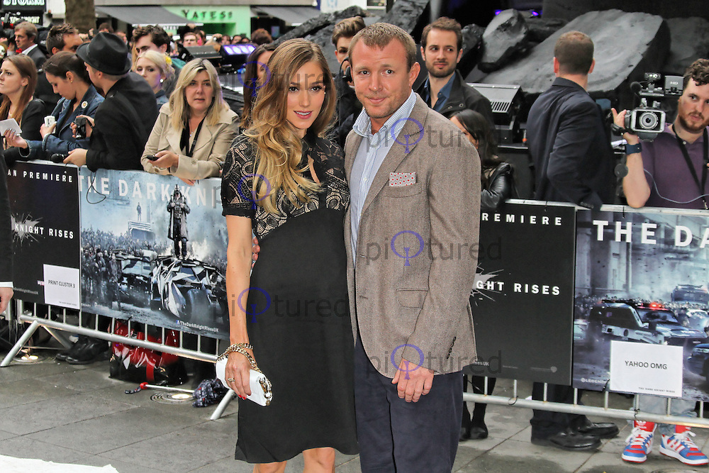 LONDON - JULY 18: Jacqui Ainsley; Guy Ritchie attended the European Film Premiere of 'The Dark Knight Rises' in Leicester Square, London, UK. July 18, 2012. (Photo by Richard Goldschmidt)