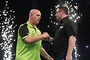 Michael van Gerwen and James Wade  share the points during the PDC Premier League Darts at Arena Birmingham, Birmingham, United Kingdom on 25 April 2019.