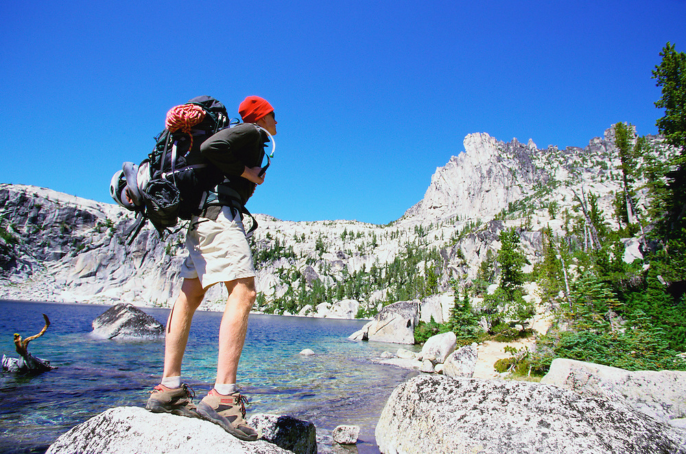 Young male backpacker by alpine lake&#xA;<br />