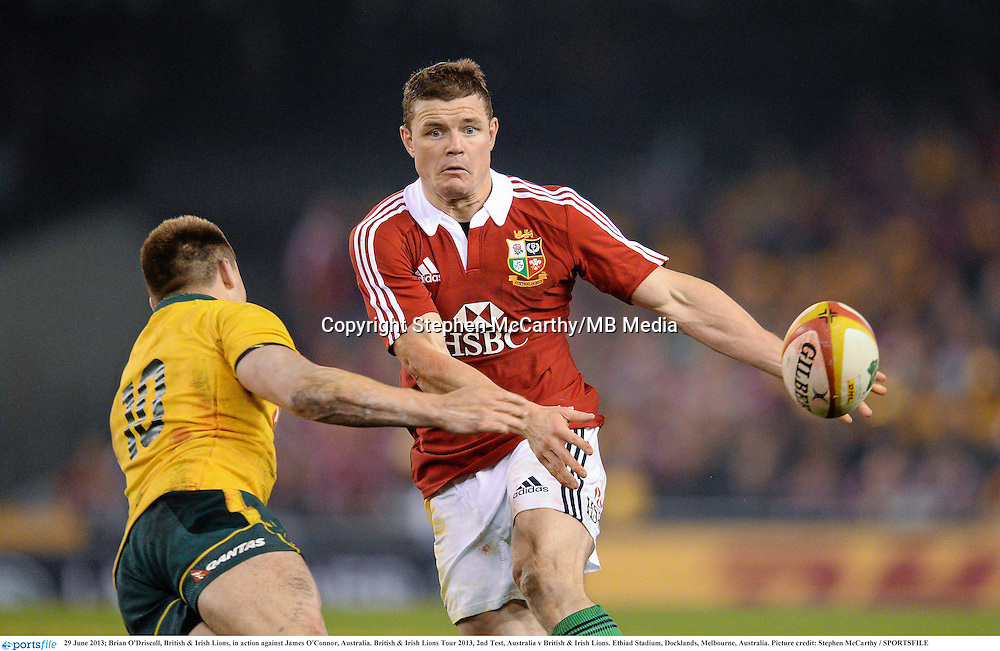 29 June 2013; Brian O'Driscoll, British & Irish Lions, in action against James O'Connor, Australia. British & Irish Lions Tour 2013, 2nd Test, Australia v British & Irish Lions. Ethiad Stadium, Docklands, Melbourne, Australia. Picture credit: Stephen McCarthy / SPORTSFILE