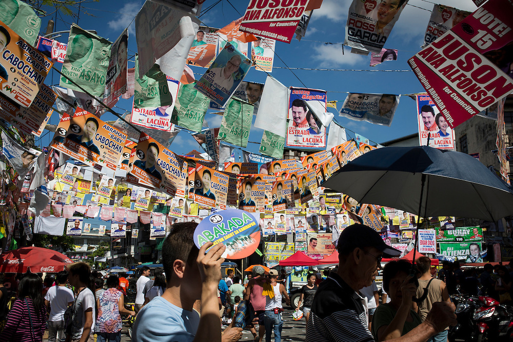 MANILA, PHILIPPINES - MAY 9: Posters of candidates hanging in front of the voting station in Paaralang Timoteo Paez Elementary School in Tondo, Manila, Philippines on Monday morning of May 9, 2016. <br /> <br /> Photo by Richard A. de Guzman