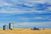 Grain bins, tractor and auger<br /> near Beechy<br /> Saskatchewan<br /> Canada