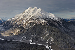 An unamed mountain peak on Takhin Ridge towers above the Takhin River in southeast Alaska near Haines. The peak, seen in this aerial photo is near Chunekukleik Mountain (not visible in photo).
