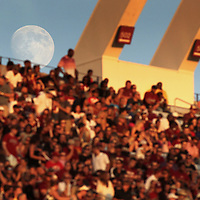 The moon rises over Williams-Brice Stadium in Columbia, S.C. ©Travis Bell Photography
