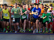 Overall winner Boo Bryant starts his watch at the beginning of the Dash Down Greenville 5k in Dallas on Saturday, March 16, 2013. (Cooper Neill/The Dallas Morning News)
