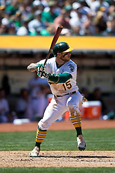 OAKLAND, CA - JUNE 21:  Brett Lawrie #15 of the Oakland Athletics at bat against the Los Angeles Angels of Anaheim during the fourth inning at O.co Coliseum on June 21, 2015 in Oakland, California. The Oakland Athletics defeated the Los Angeles Angels of Anaheim 3-2. (Photo by Jason O. Watson/Getty Images) *** Local Caption *** Brett Lawrie