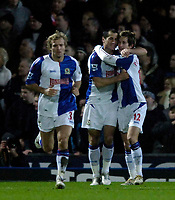 Photo: Jed Wee.<br /> Blackburn Rovers v Manchester United. Carling Cup. Semi Final, 1st Leg. 11/01/2006.<br /> <br /> Blackburn's Morten Gamst Pedersen (R) is congratulated by Shefki Kuqi (C) after scoring their equaliser.