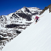 Lynsey Dyer skiing a ridgline in the backcountry of Glacier National Park.