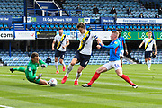 Sam Eastwood (1) of Oxford United makes a save as Andy Cannon (14) of Portsmouth closes in with Rob Dickie (4) of Oxford United during the EFL Sky Bet League 1 Play Off leg 1 of 2 match between Portsmouth and Oxford United at Fratton Park, Portsmouth, England on 3 July 2020.