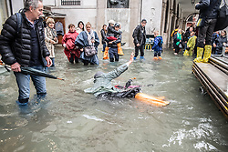 October 29, 2018 - Venice, Italy - Woman falls over. Weather emergency In Venice, italy, on 29 October 2018 due to the High water: almost all the city have been underwater with a maximum level reached of 160cm on the sea level. (Credit Image: © Giacomo Cosua/NurPhoto via ZUMA Press)