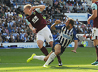 Football - 2019 / 2020 Premier League - Brighton & Hove Athletic vs. Burnley<br /> <br /> Glenn Murray of Brighton and Ben Mee of Burnley, at The Amex.<br /> <br /> COLORSPORT/ANDREW COWIE