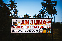 A small general store sign on Anjuna Beach, in northern Goa, India.