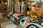 A totem pole in the Alaska Indian Arts skill center, in Fort William H. Seward National Historic Landmark, at Port Chilkoot, in Haines, Alaska, USA. Also known as Chilkoot Barracks and Haines Mission, Fort Seward (1902-1945) was the last of 11 military posts in Alaska during the gold rush era, and Alaska's only military facility between 1925 and 1940. It policed miners moving into the gold mining areas in the Alaskan interior, and provided military presence during negotiations over the nearby international border with Canada. William H. Seward was the United States Secretary of State who oversaw the Alaska purchase.