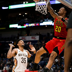 Mar 26, 2019; New Orleans, LA, USA; Atlanta Hawks forward John Collins (20) dunks over New Orleans Pelicans forward Christian Wood (35) during the second quarter at the Smoothie King Center. Mandatory Credit: Derick E. Hingle-USA TODAY Sports