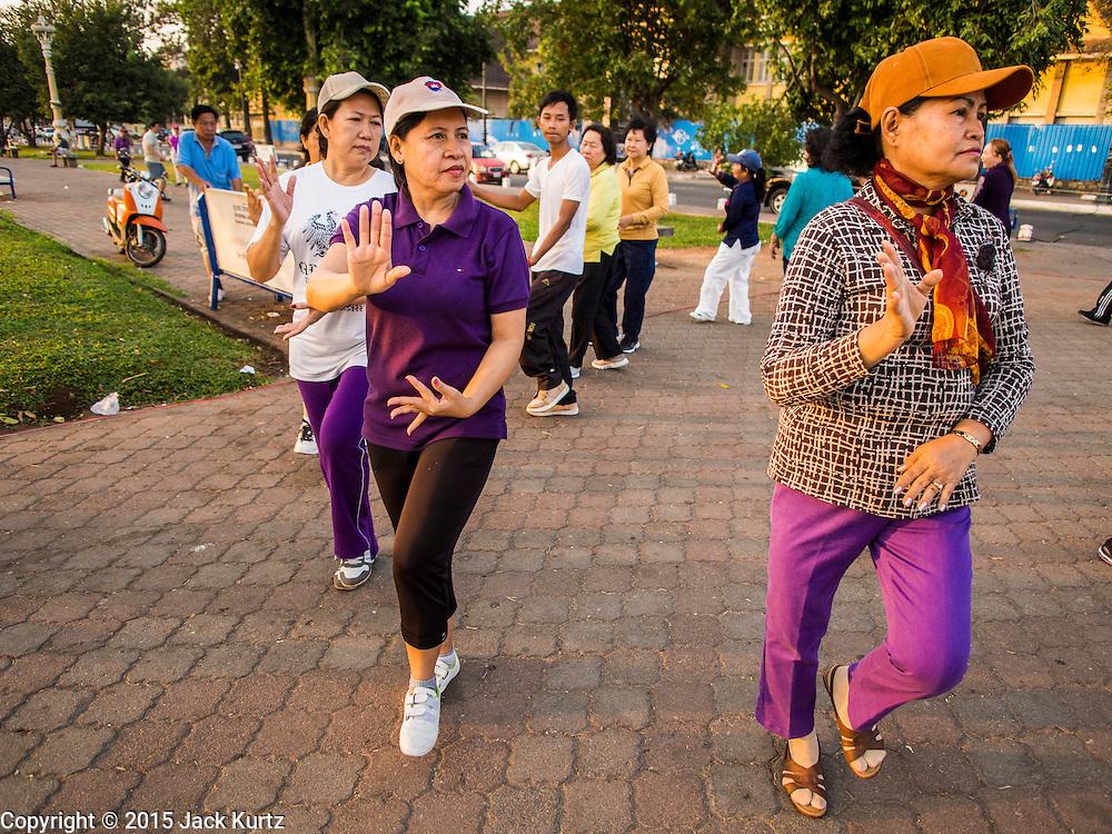 24 FEBRUARY 2015 - PHNOM PENH, CAMBODIA: Women do aerobic exercises set to Cambodian pop music on the riverfront in Phnom Penh.    PHOTO BY JACK KURTZ