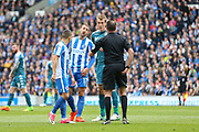 Brighton & Hove Albion centre forward Glenn Murray (17) and Brighton & Hove Albion winger Anthony Knockaert (11) argue with Match referee James Linington and Wigan Athletic defender Dan Burn (33) during the EFL Sky Bet Championship match between Brighton and Hove Albion and Wigan Athletic at the American Express Community Stadium, Brighton and Hove, England on 17 April 2017. Photo by Phil Duncan.