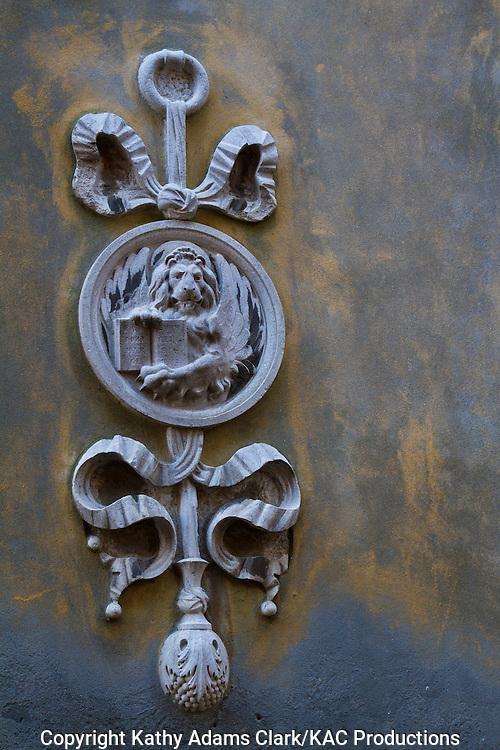 Street ornament near Church of St. Rocco, on Calle Fianco de la Scuola, in Venice, Italy,