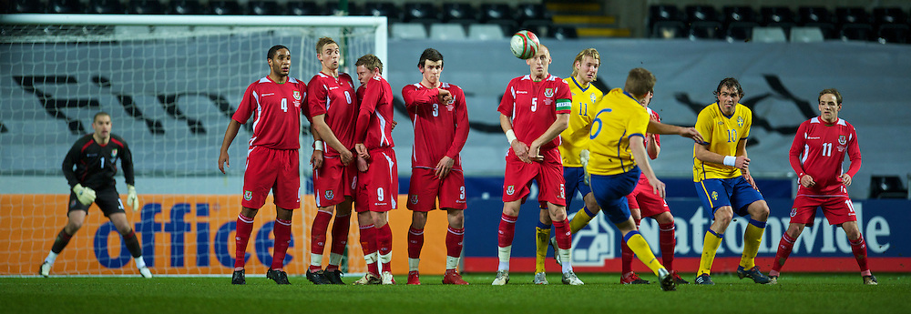 SWANSEA, WALES - Wednesday, March 3, 2010: Wales' players defend a free-kick from Sweden's Sebastian Larsson during the international friendly match at the Liberty Stadium. L-R: Ashley Williams, Jack Collison, Simon Church, Gareth Bale, captain James Collins. (Photo by David Rawcliffe/Propaganda)