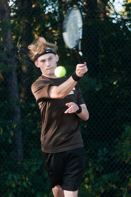 Lathan Goumas | The Bay City Times..Sawyer Samborn of the Bay City Western High School tennis team hits the ball during the 2011 City By the Bay Invitational Tennis Tournament at Garber High School in Essexville, MI., on Saturday September 24, 2011.