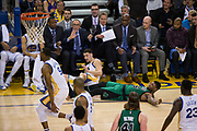 Golden State Warriors guard Klay Thompson (11) and Boston Celtics guard Marcus Smart (36) collide during a three point attempt at Oracle Arena in Oakland, Calif., on March 8, 2017. (Stan Olszewski/Special to S.F. Examiner)