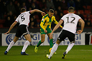 West Bromwich Albion forward Dwight Gayle (16) is held up by Sheffield United defender Jack O'Connell (5)  and Sheffield United defender John Egan (12) . during the EFL Sky Bet Championship match between Sheffield United and West Bromwich Albion at Bramall Lane, Sheffield, England on 14 December 2018.