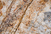Orange and white rock pattern, in Rio Achin Valley. Geology: Cordillera Huayhuash is comprised of uplifted sedimentary sea floor rocks (quartzite, limestone, slate) with a base of granodiorite. Day 9 of 9 days trekking around the Cordillera Huayhuash in the Andes Mountains, near LLamac, Peru, South America.