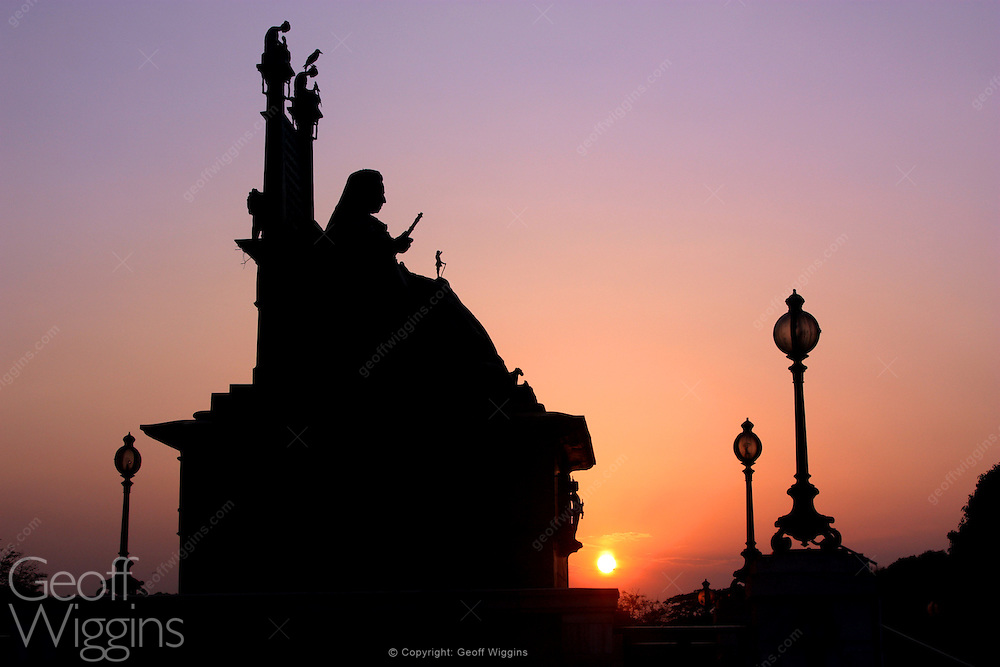 Sun sets over the Queen Victoria monument at Victoria Park, Kolkata the capital of West Bengal, India