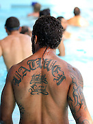 Warrior's Manu Vatuvei at their pool session after training at Carisbrook, Moana pool, Dunedin, New Zealand, Friday, February 20, 2013. Credit:NINZ / Dianne Manson.