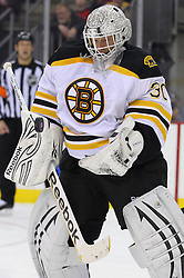 Jan 19; Newark, NJ, USA; Boston Bruins goalie Tim Thomas (30) makes a save during the second period at the Prudential Center.