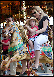 Autumn Phillips ride on the fair rides with her daughter Isla Phillips at the Windsor Horse Show. Windsor, United Kingdom. Saturday, 17th May 2014. Picture by Andrew Parsons / i-Images