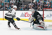 Jan 26, 2019; San Jose, CA, USA; Atlantic Division player David Pastrnak (88) of the Boston Bruins shoots against Metropolitan Division goaltender Braden Holtby (70) of the Washington Capitals in the 2019 NHL All Star Game at SAP Center.