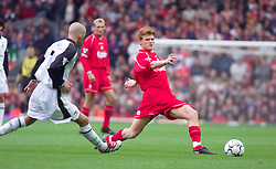 LIVERPOOL, ENGLAND - Sunday, November 4, 2001: Liverpool's John Arne Riise and Manchester United's David Beckham during the Premiership match at Anfield. (Pic by David Rawcliffe/Propaganda)