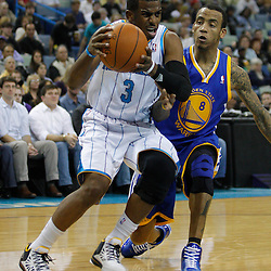 January 5, 2011; New Orleans, LA, USA; New Orleans Hornets point guard Chris Paul (3) drives past Golden State Warriors shooting guard Monta Ellis (8)during the first half at the New Orleans Arena.   Mandatory Credit: Derick E. Hingle
