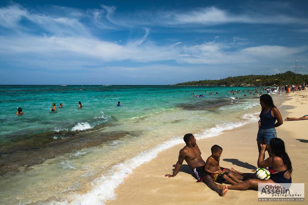 A Cuban family enjoyes the beach at Maguana beach, near Baracoa, Cuba on Sunday July 13, 2008.