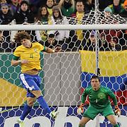 David Luiz, Brazil, heads clear during the Brazil V Colombia International friendly football match at MetLife Stadium, New Jersey. USA. 14th November 2012. Photo Tim Clayton
