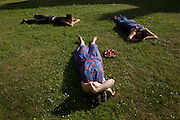 Volunteers doze on lawn after long working day at the Rivendell Buddhist Retreat Centre, East Sussex, England.