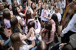 © Licensed to London News Pictures . 22/05/2019. Manchester, UK . Several young girls who survived the concert attack congregate and sing Ariana Grande songs to one another . People in St Ann's Square in Manchester City Centre on the second anniversary of the Manchester Arena bombing following a private service in St Ann's Church . On the evening of 22nd May 2017 , Salman Abedi murdered 22 people and seriously injured dozens more , when he exploded a bomb in the foyer of the Manchester Arena as concert-goers were leaving an Ariana Grande gig . Photo credit: Joel Goodman/LNP