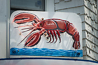 Neon lobster sign on a lobster shack restaurant on Cape Cod, MA, U.S.A.