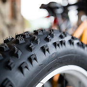 A sign of winter to come with a monster snow bike tire on the exterior of Fitzgerald's Bike and Coffee Shop in Victor, Idaho.
