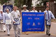 Members of the Solomon's Lodge Masonic Order march down Meeting Street to celebrate Carolina Day June 28, 2014 in Charleston, SC. Carolina Day celebrates the 238th anniversary of the American victory at the Battle of Sullivan's Island over the Royal Navy and the British Army.