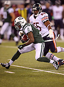 New York Jets wide receiver Jeremy Kerley (11) is chased by Chicago Bears outside linebacker Lance Briggs (55) as he runs with the ball after catching a third quarter pass for a first down during the NFL week 3 regular season football game against the Chicago Bears on Monday, Sept. 22, 2014 in East Rutherford, N.J. The Bears won the game 27-19. ©Paul Anthony Spinelli
