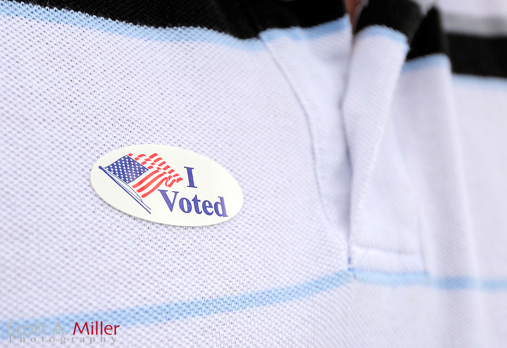 A voter wears an I Voted sticker after voting  at the Robert Guevara Community Center  in Kissimmee, Florida November 6, 2012.  ©2012 Scott A. Miller