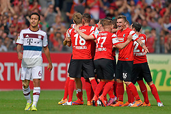 Football: Germany, 1. Bundesliga, SC Freiburg - FC Bayern Muenchen, Freiburg - 16.05.2015,<br /> Thiago (Bayern) dejected, Players of Freiburg celebrating at the end of the match<br /> <br /> &copy; pixathlon<br /> <br /> +++ NED out !!! +++