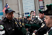DSNY Emerald Society's Pipes and Drums at the Columbus Day Parade. Manhattan. October 2009.