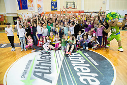 Players and kids of Athlete Celje celebrate after winning during basketball match between ZKK Athlete Celje and ZKK Triglav in Finals of 1. SKL for Women 2014/15, on April 20, 2015 in Gimnazija Celje Center, Celje, Slovenia. ZKK Athlete Celje became Slovenian National Champion 2015. Photo by Vid Ponikvar / Sportida
