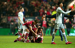 Jamie Paterson and Bobby Reid celebrate with Korey Smith of Bristol City after his winning goal puts his side into the semi final of the Carabao Cup - Mandatory by-line: Robbie Stephenson/JMP - 20/12/2017 - FOOTBALL - Ashton Gate Stadium - Bristol, England - Bristol City v Manchester United - Carabao Cup Quarter Final