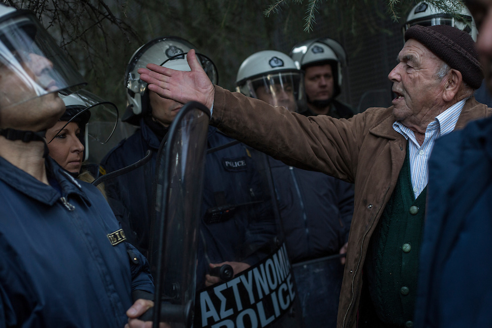 A farmer shouts to riot police as they block farmers way during a march inside the city of Thessaloniki, Greece, on the 2nd of February 2017. Farmers from around northern Greece gathered in Thessaloniki during the opening of the Zootechnia international livestock to demonstrate against the austerity measures put by the Greek government.
