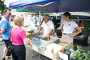 Bruce and Nancy, owners of Red Dog Farm, sell their produce every Saturday at the Ashland Farmers Market. They say the primary reason they attend the market is to socialize, not sell vegetables.