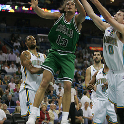 Bulls forward Joakim Noah #13 scrambles for a loose ball with Hornets forward  Ryan Bowen #40 during the first half of their NBA game against the New Orleans Hornets on March 17, 2008 at the New Orleans Arena in New Orleans, Louisiana. The New Orleans Hornets defeated the Chicago Bulls 108-97.